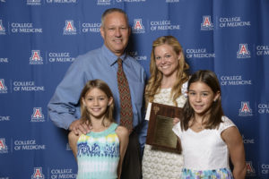 Dr. Sam Goldfein's son Nathan, and his granddaughters Ahava and Ziva present the 2016 Dr. Sam Golden Award to UA medical student Katherine Nielson.